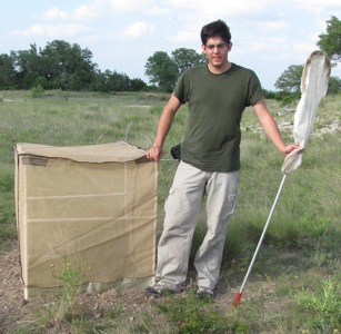Paul Lenhart and one of his grasshopper gladiator cages on the Gainer tract.